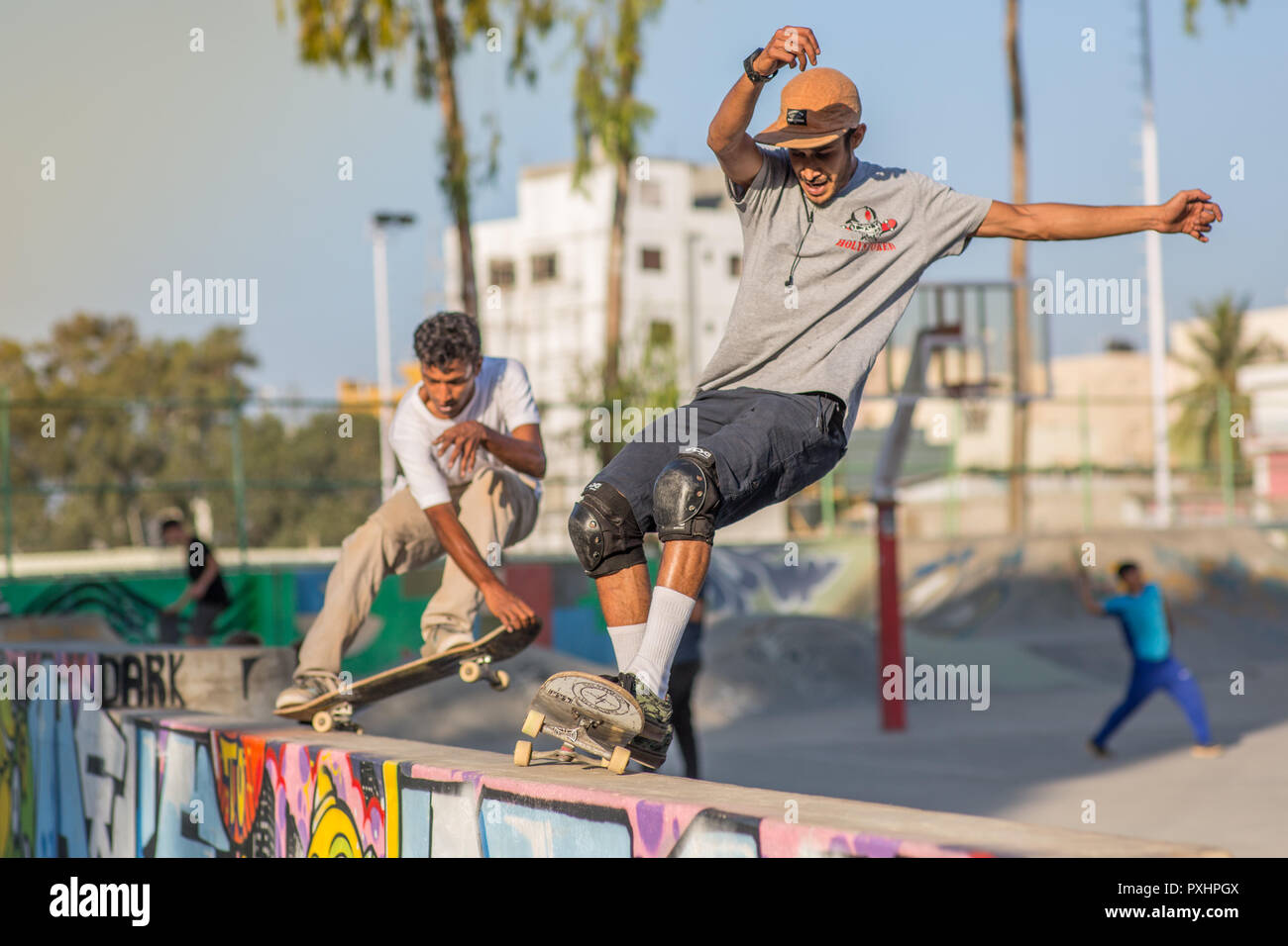 Two Indian skateboarders at a skatepark in Bangalore. - Stock Image