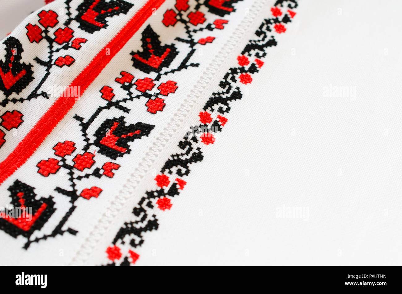 Slavic Cross Stitch by Red and Black Threads in the View of Viburnum. Ukrainian Folk Embroidery Pattern. Hemming. - Stock Image