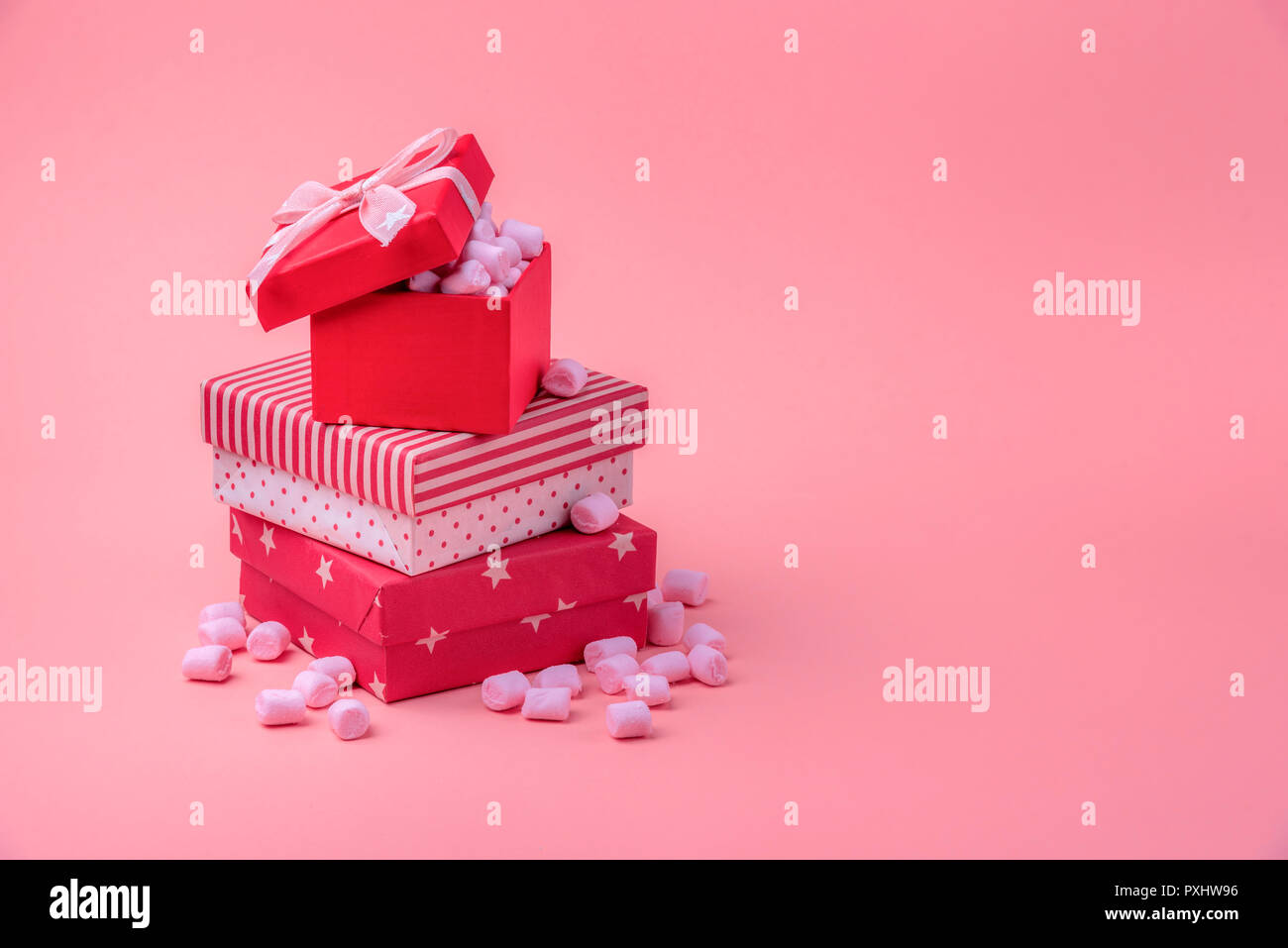 Christmas gifting theme image with a stack of gifts wrapped in ...