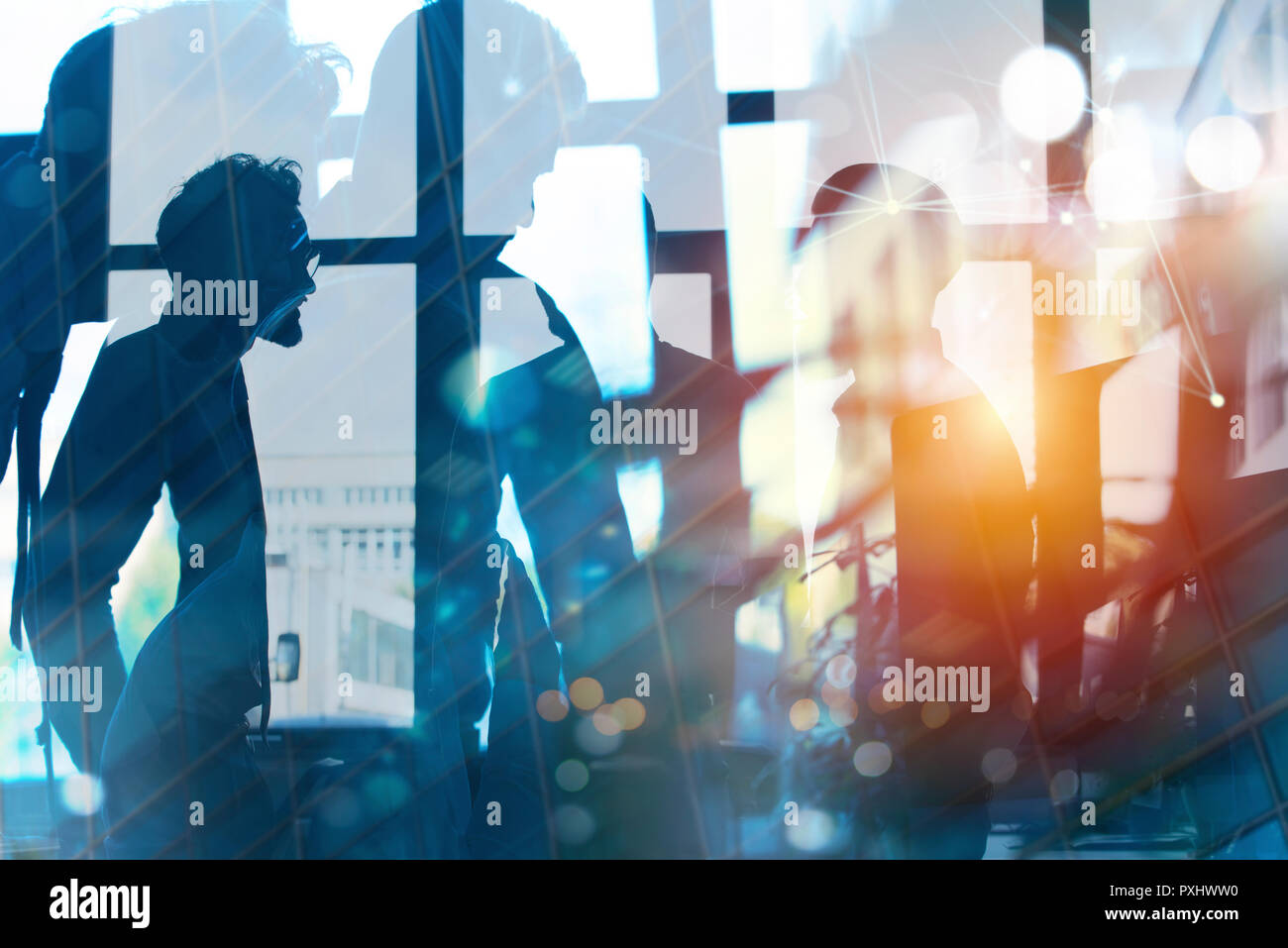 Businessmen that work together in office. Concept of teamwork, partnership and startup. double exposure Stock Photo