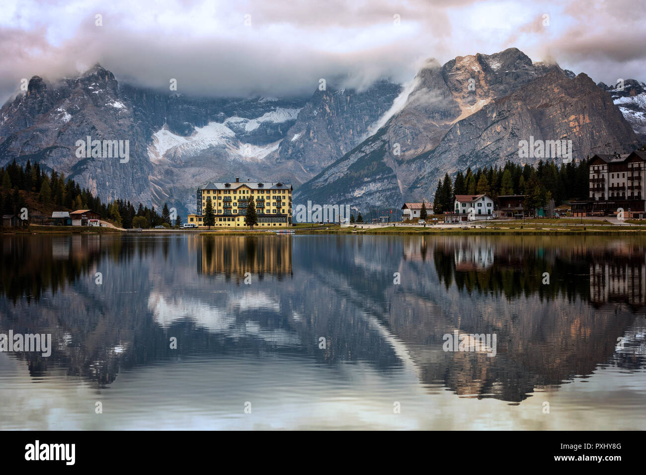 View of Punta Sorapis mountain of the Dolomites in the morning with the reflection on the famous lake Misurina at Cortina d'Ampezzo in Italy Stock Photo