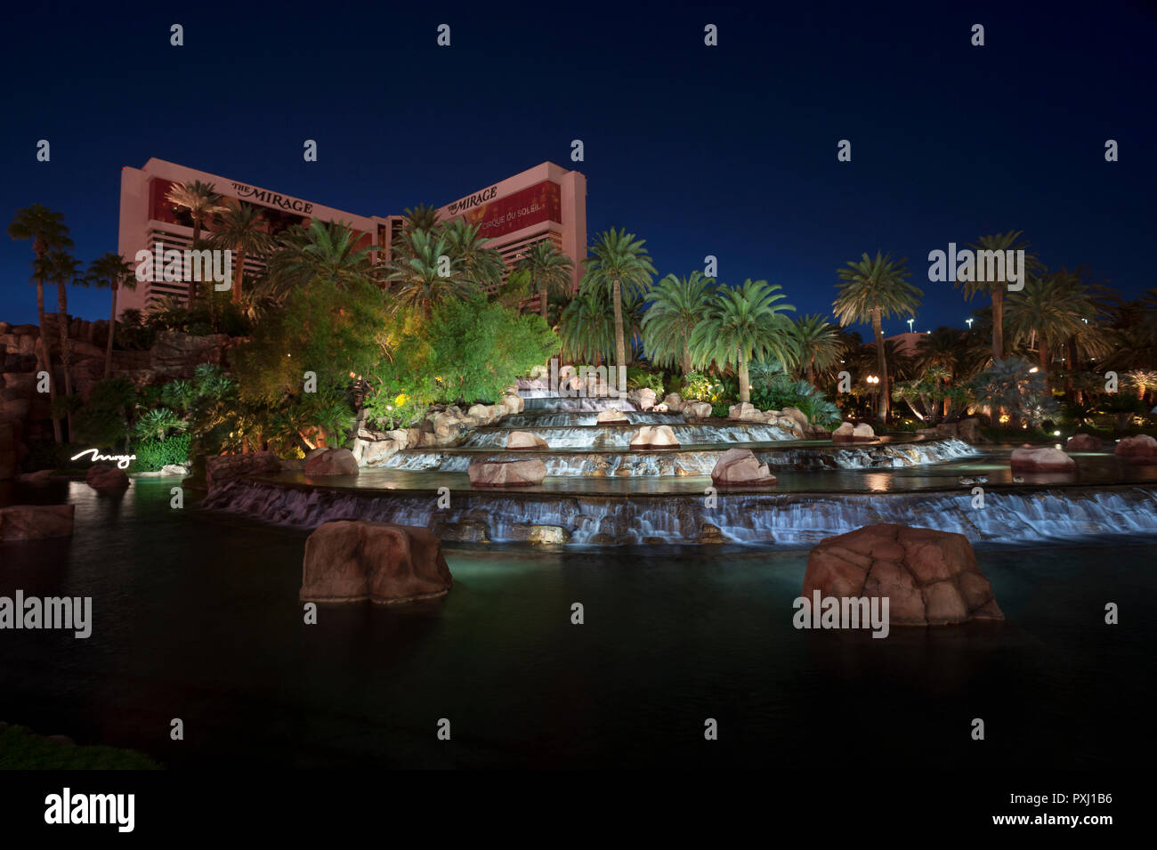 The Mirage Hotel and its tropical oasis and cascade at blue hour, Las Vegas, Nevada. - Stock Image