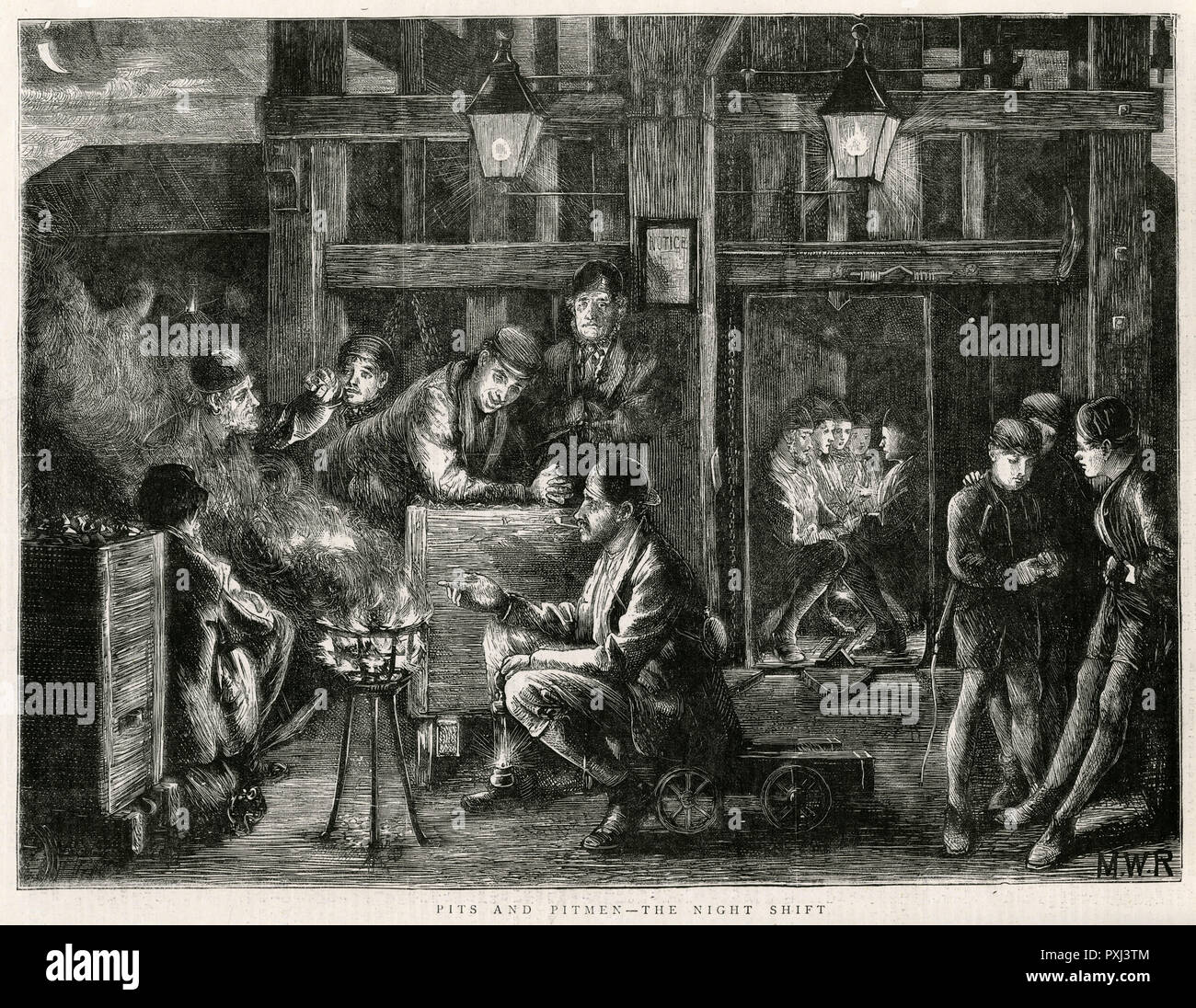 Night-shift down the pits, half an hour before the shift starts at five-thirty in the evening, the miners meet on the pit-heap for a chat by a fire, this engraving was took from Seaham, pitmen sent half their llife down the mines and could tell you many thrilling stories.     Date: 1871 - Stock Image