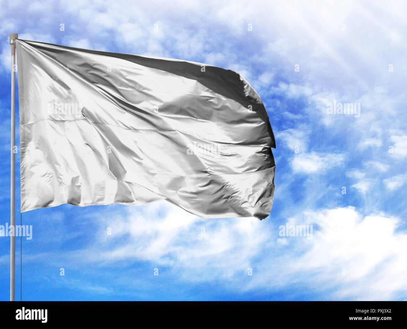 flag of White on a flagpole in front of blue sky. - Stock Image