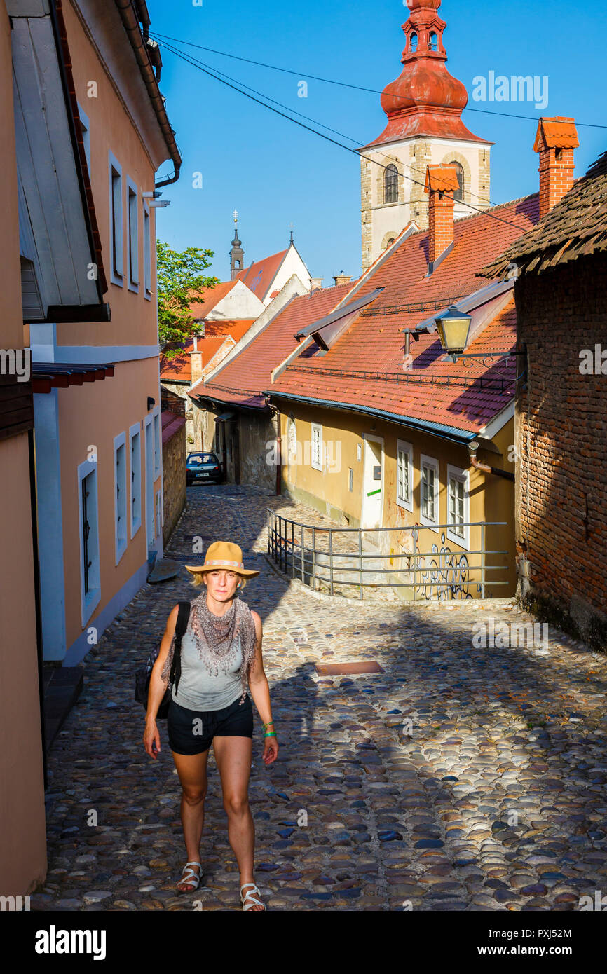 Tourist in a street. - Stock Image