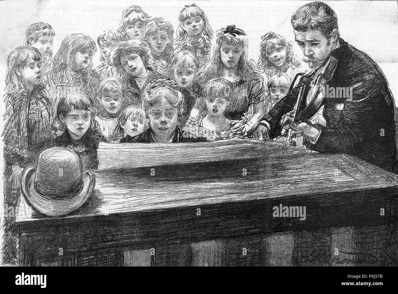 A group of child performers rehearse the 'Lullaby' for a pantomime, accompanied by piano and fiddle.      Date: 1889 - Stock Image