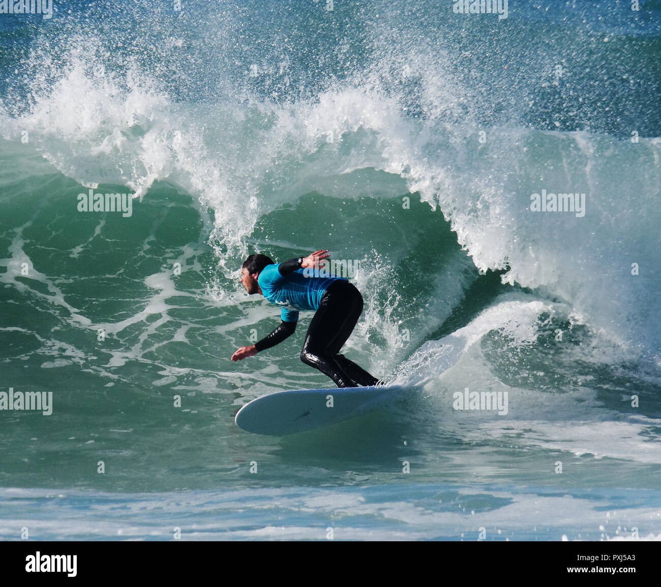Beach individuals enjoy October sunshine at Fistral Beach cornwall UK during a surf contest 2018. - Stock Image