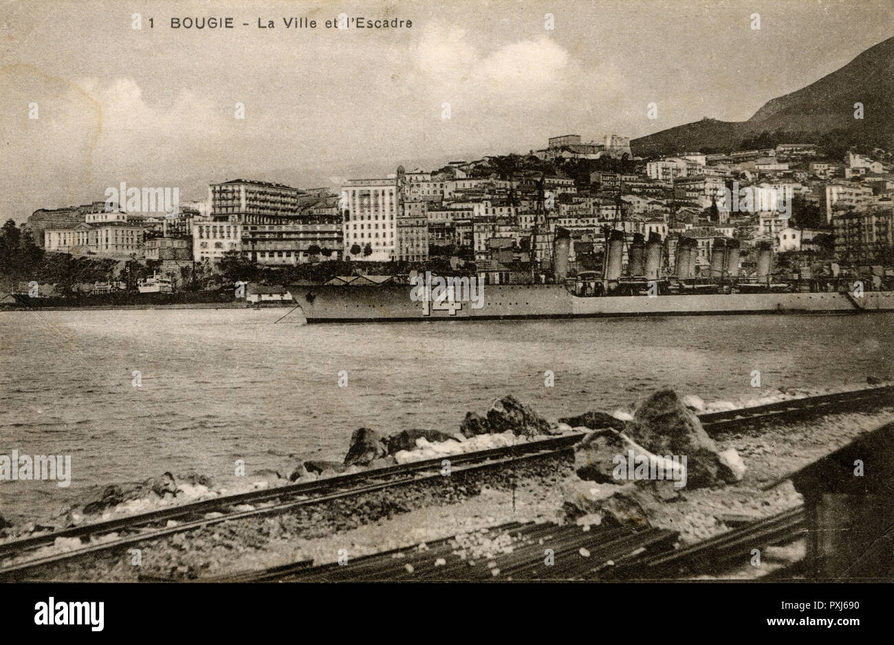 Algeria - Bejaia (formerly Bougie or Bugia) - The Town and French Naval Squadron stationed there at this time.     Date: circa 1910s Stock Photo