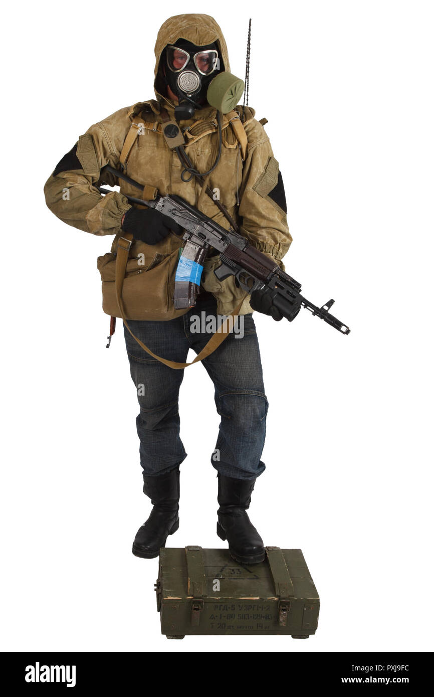 Post-apocalyptic fiction concept - stalker in gas mask with weapon and ammunition box isolated on white. Text on box in russian - type of ammunition ( - Stock Image