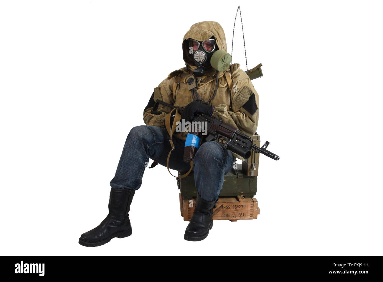 Post-apocalyptic fiction concept - stalker in gas mask with weapon and ammunition box isolated on white. Text on box in russian - type of ammunition a - Stock Image