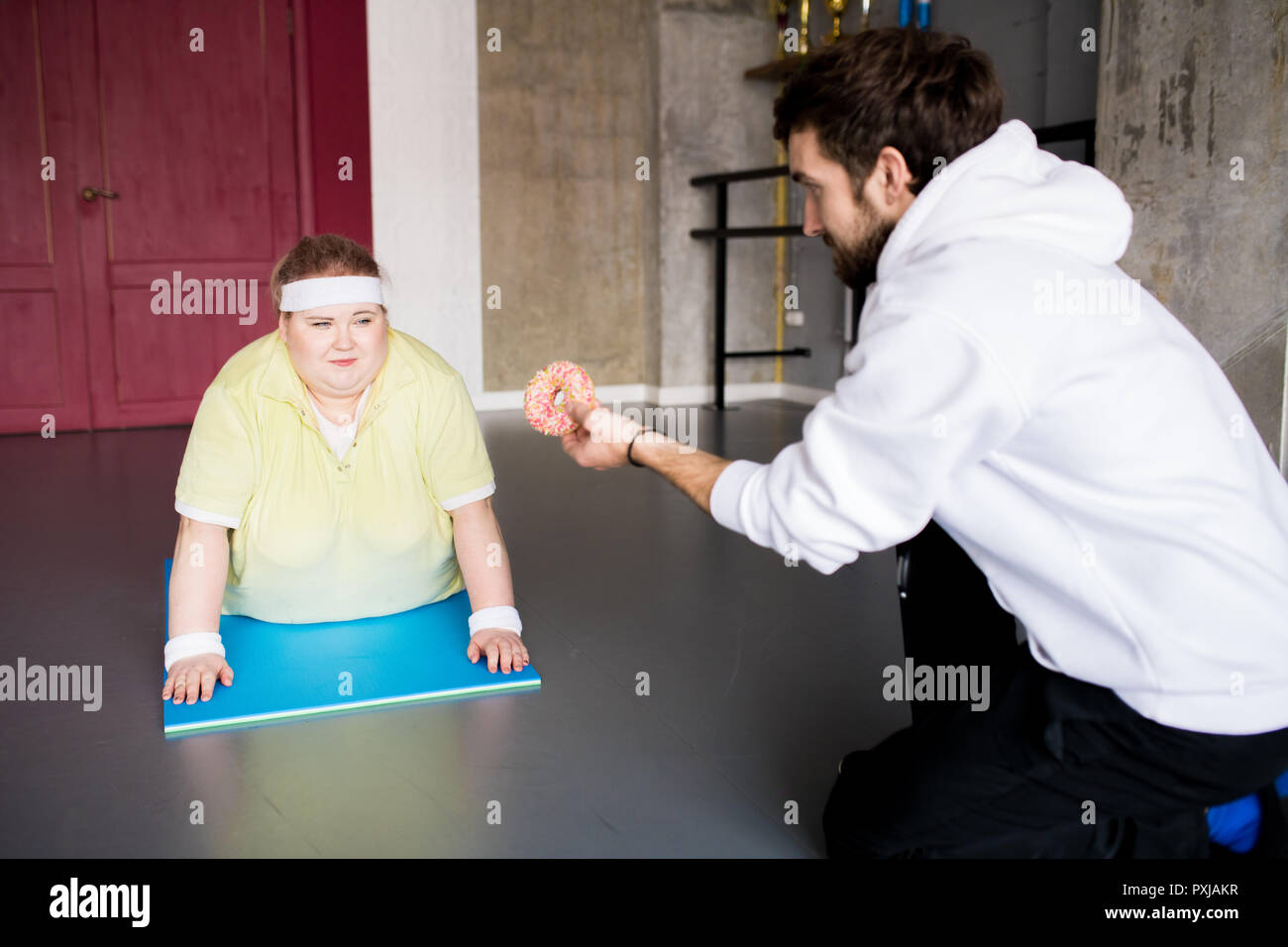 Woman Fighting Food Obsession - Stock Image