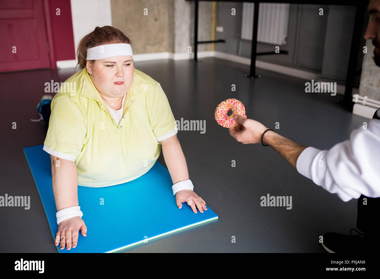 Obese Woman Fighting Food Obsession - Stock Image