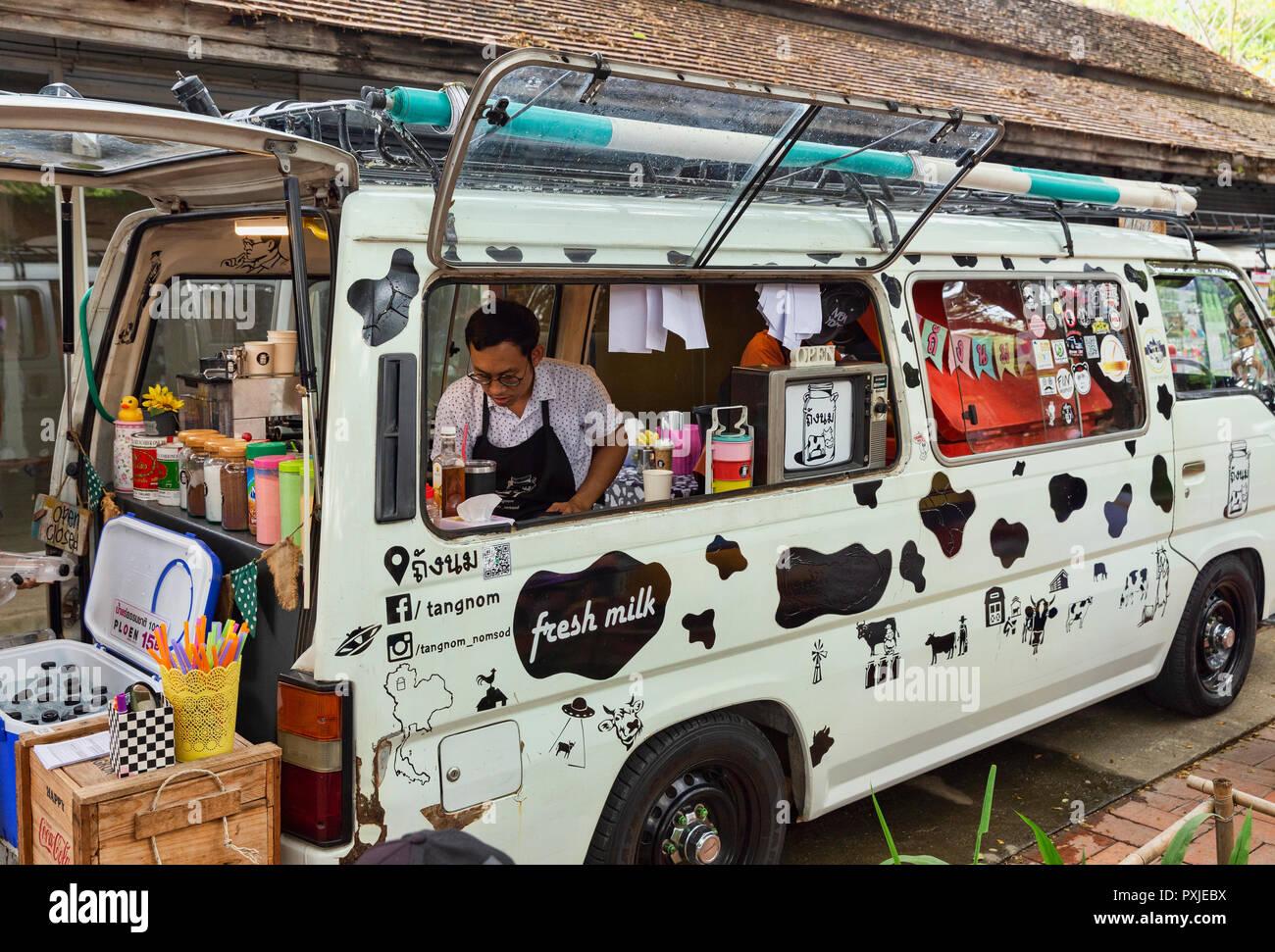 Van converted to mobile coffee shop at JingJai Farmer's Market, Chiang Mai, Thailand - Stock Image
