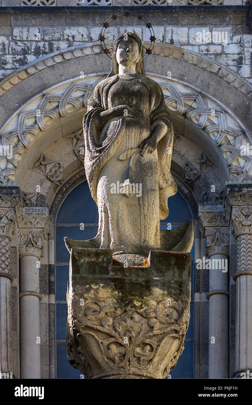 Sculpture of a saint in front of the St. Marien Liebfrauen Church, built in neo-Romanesque style 1904-1906, Berlin, Germany - Stock Image