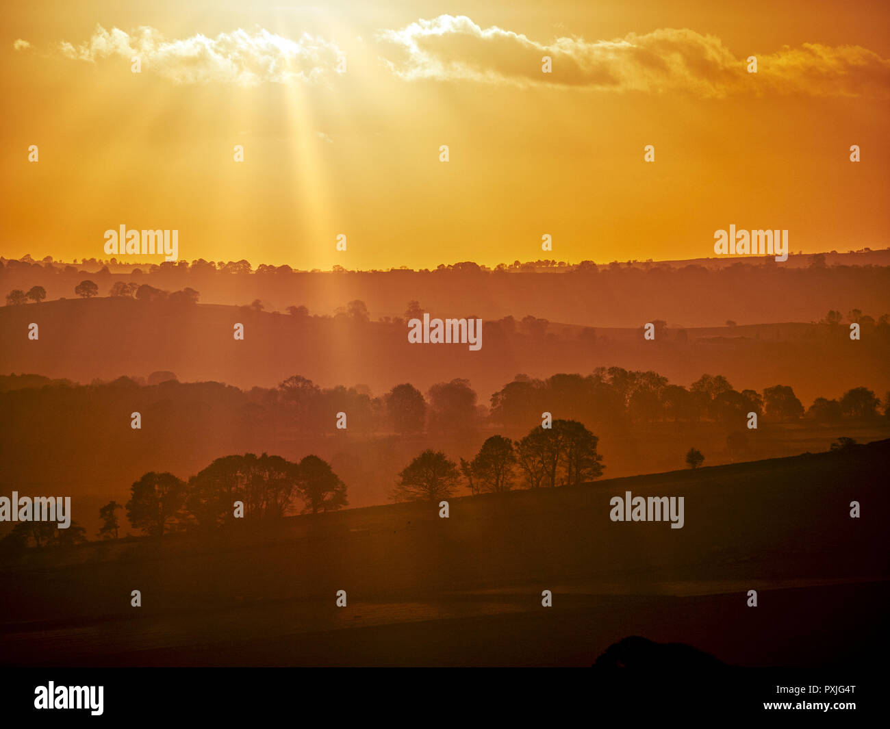 Biggan, UK. 22nd Oct, 2018. UK Weather: spectacular sunset along the A515 road between Buxton & Ashbourne in the Peak District National Park, Derbyshire Credit: Doug Blane/Alamy Live News Stock Photo