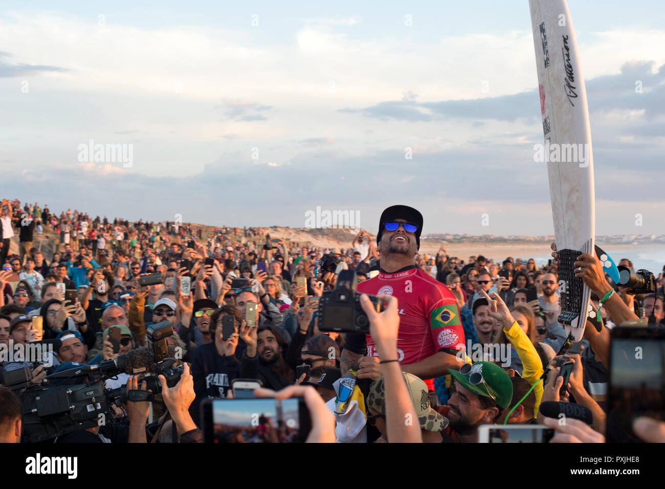 PENICHE, PORTUGAL - OCTOBER 20, 2018: Italo Ferreira celebrating victory during the World Surf League's 2018 MEO Rip Curl Pro Portugal competition - Stock Image