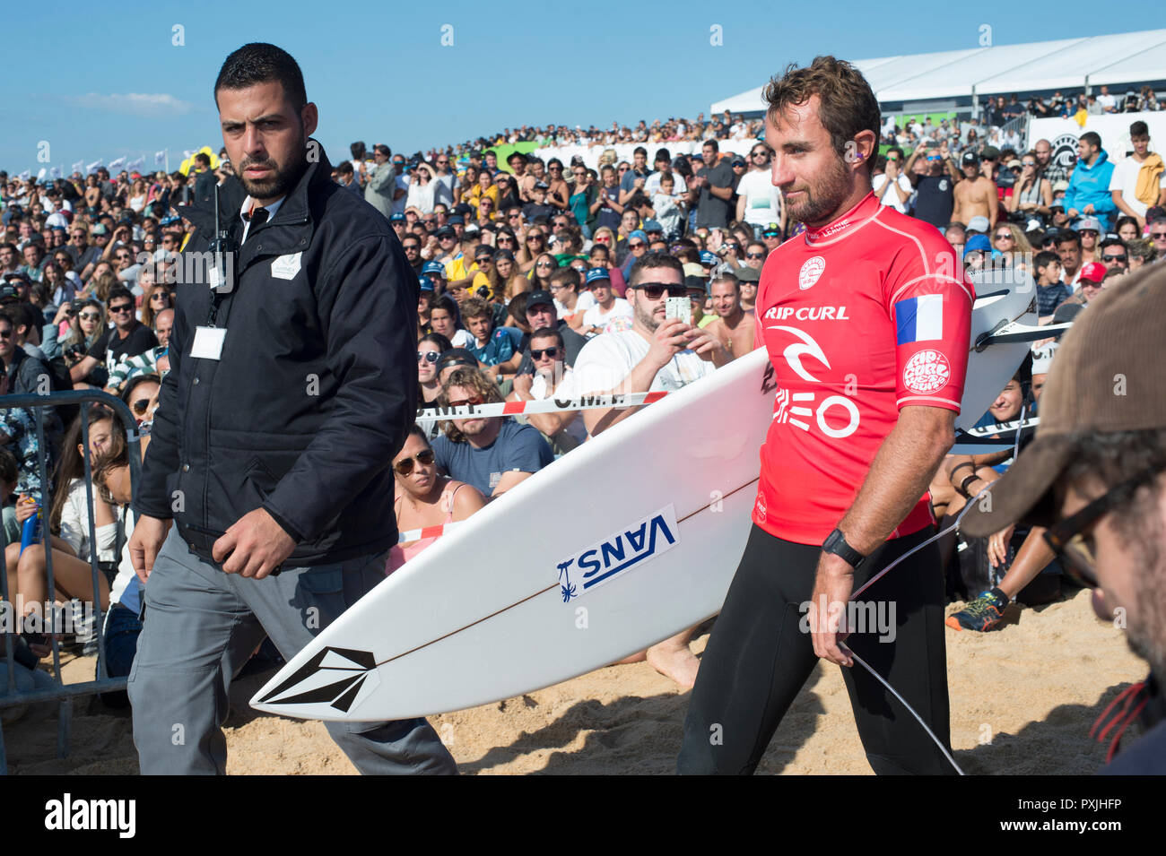 PENICHE, PORTUGAL - OCTOBER 20, 2018: Joan Duru going to the ocean among the crowd of surf funs during the World Surf League's 2018 MEO Rip Curl Pro Portugal competition - Stock Image