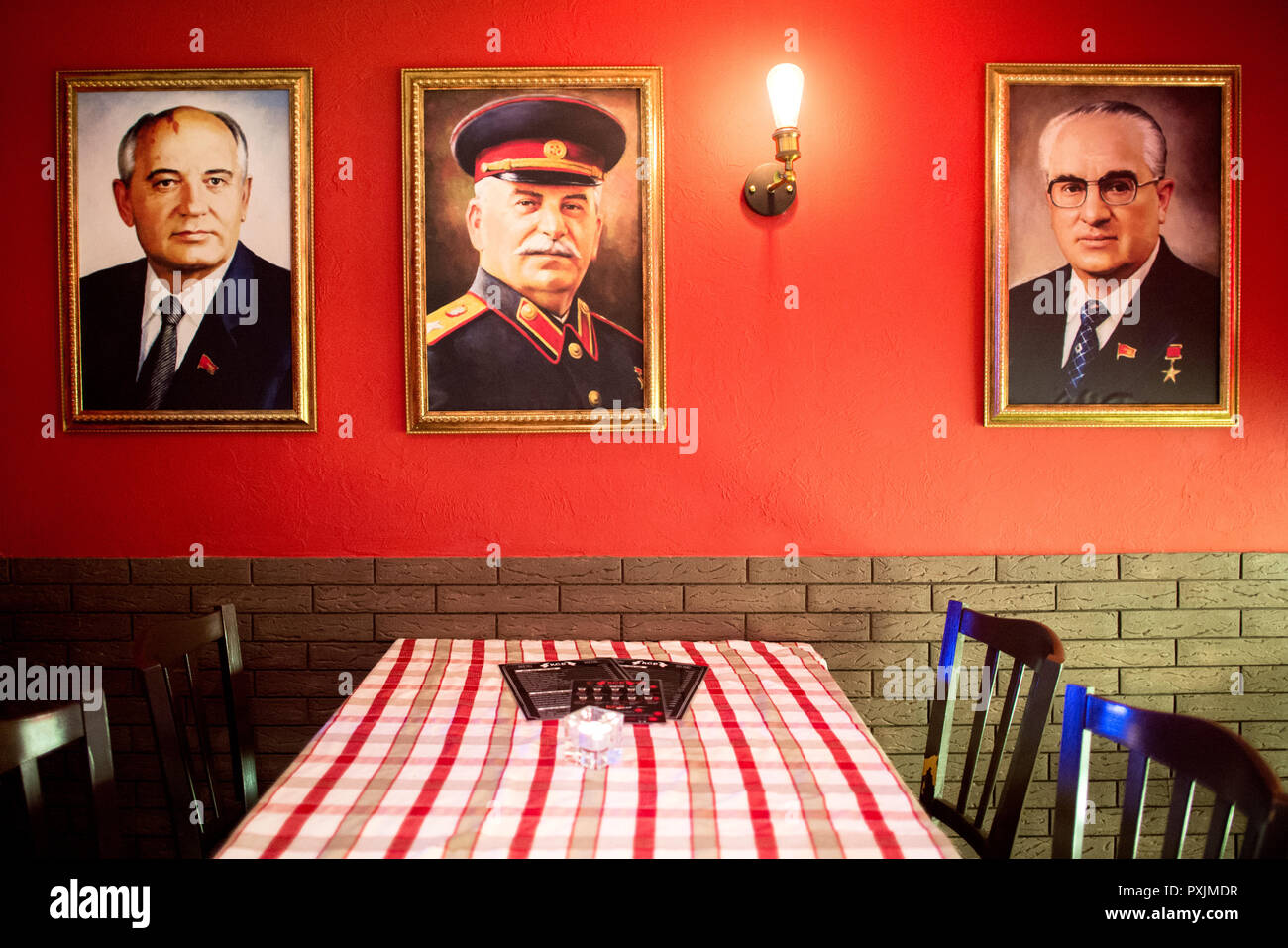 Hanover, Germany. 07th Apr, 2018. The portraits of former Soviet politicians Mikhail Gorbachev (l-r), Josef Stalin and Yuri Andropov hang in the KGB bar. With many Soviet relics, the bar in the city centre of Hanover is reminiscent of the former USSR. Credit: Hauke-Christian Dittrich/dpa/Alamy Live News - Stock Image