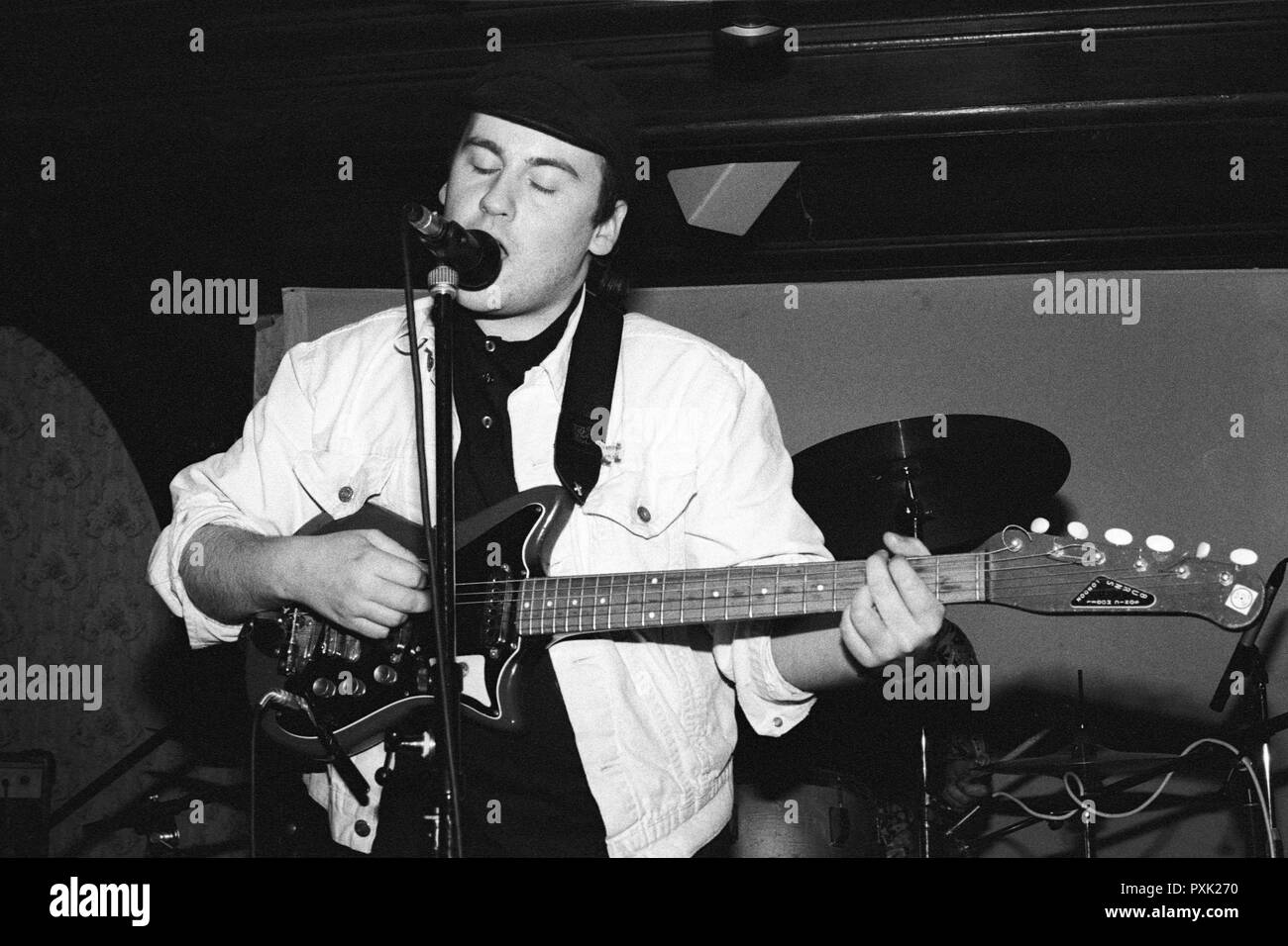 Dan Treacy, singer and guitarist of post-punk band Television Personalities performing at Esquires, Bedford, UK, in 1990. - Stock Image