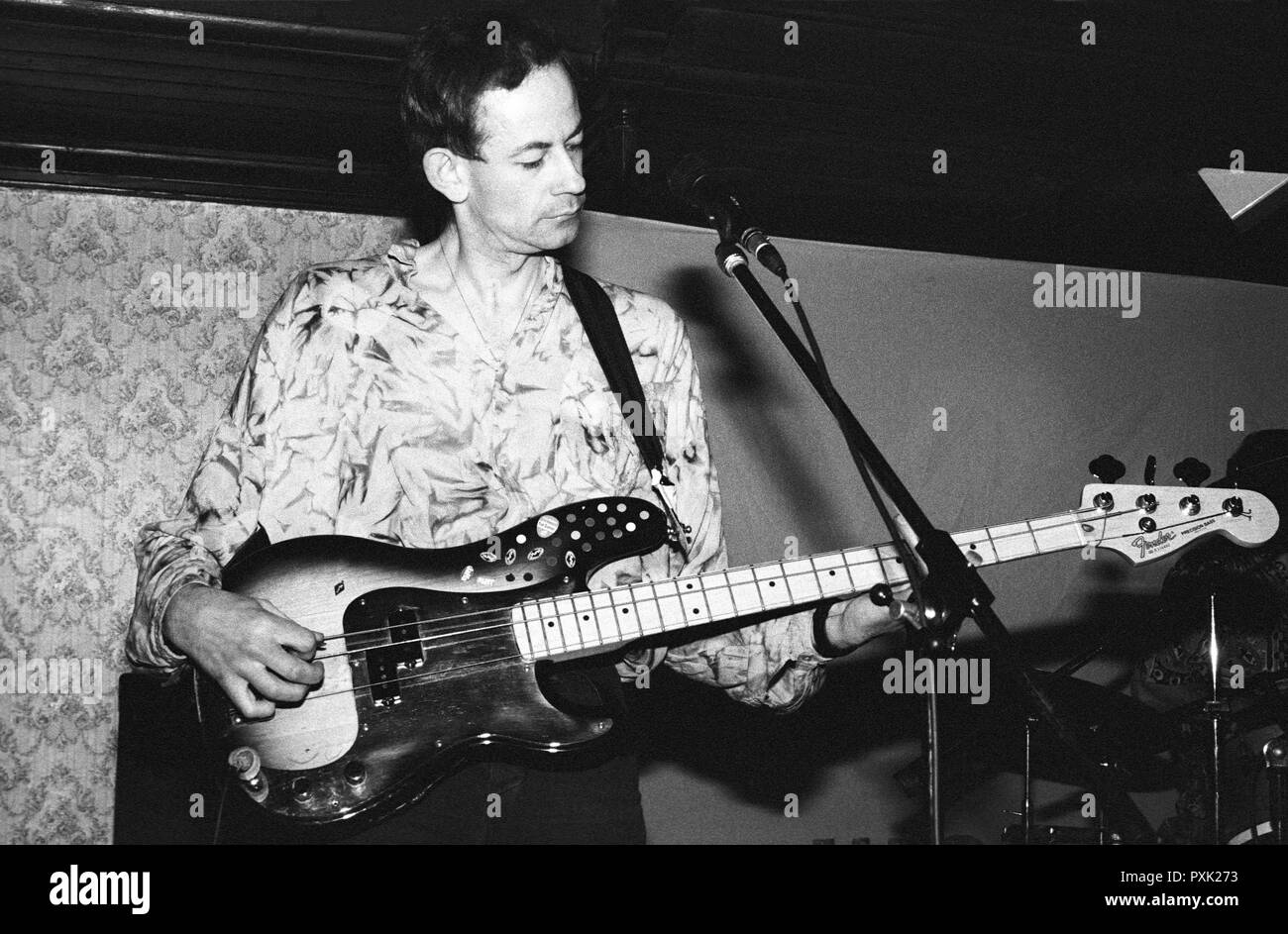 Jowe Head, bass guitarist of post-punk band Television Personalities performing at Esquires, Bedford, UK, in 1990. - Stock Image