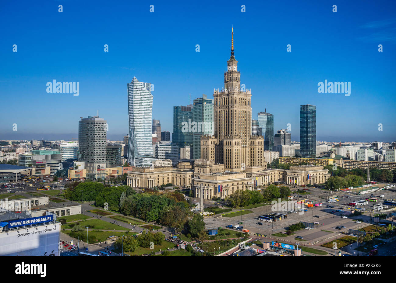 Warsaw Centrum, view of the very heart of the polish capital, with the Neomodern Warsaw Spire and the Russian Weding Cake style soc-realist Palace of  Stock Photo
