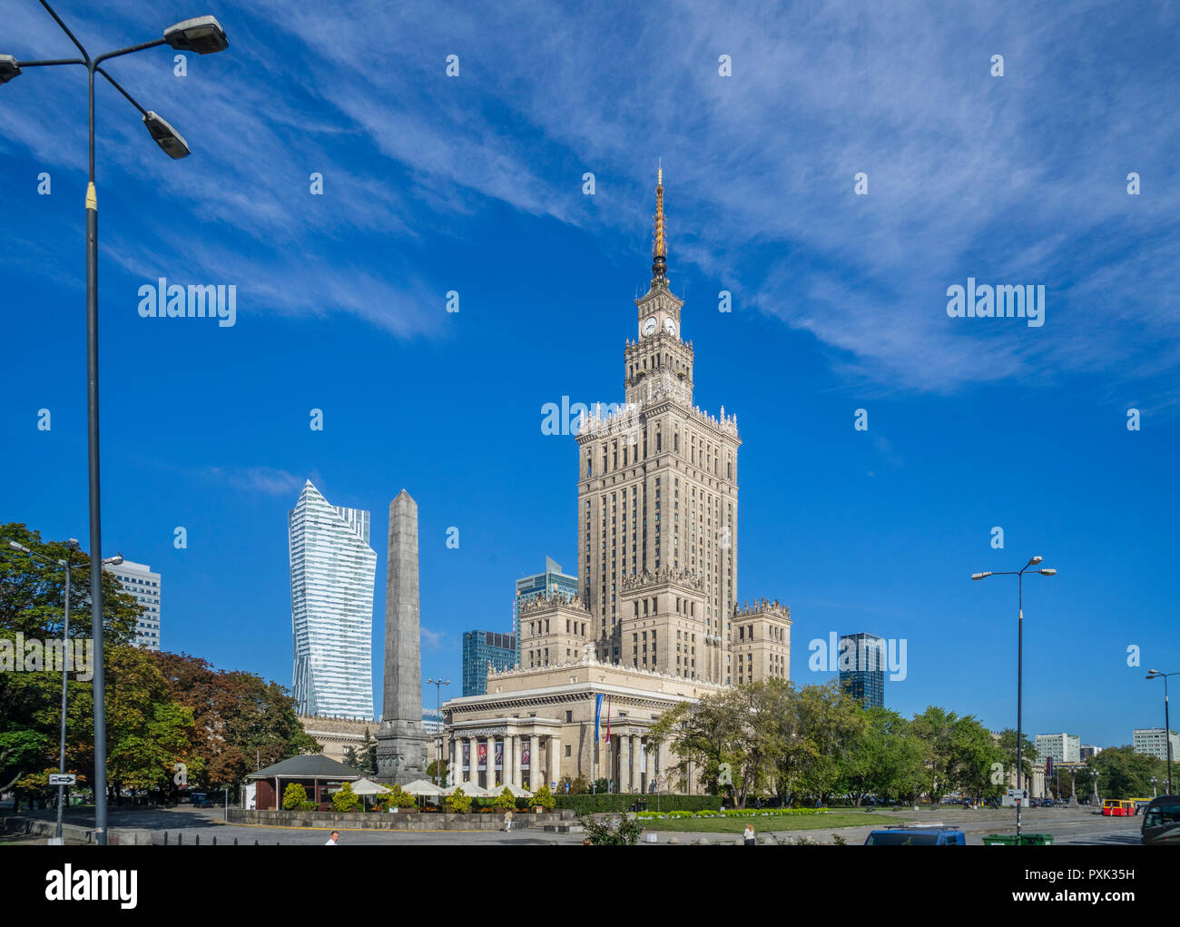 the soc-realist Russian Wedding Cake style Palace of Culture and Science with theZłota 44 skyscraper looming in the background, Warsaw, Poland - Stock Image