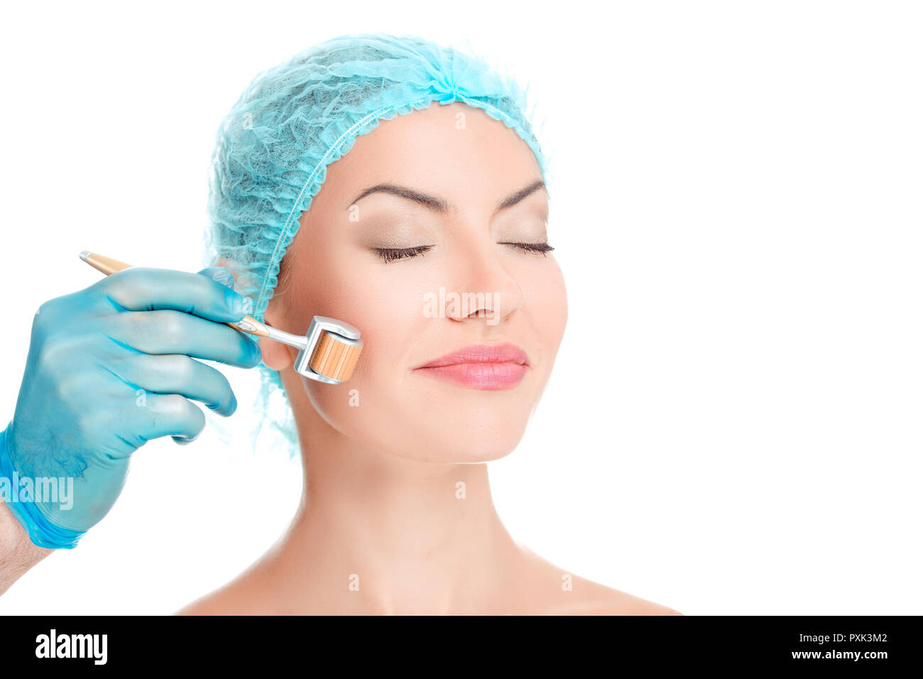 young beautiful woman having an injection mesotherapy - Stock Image