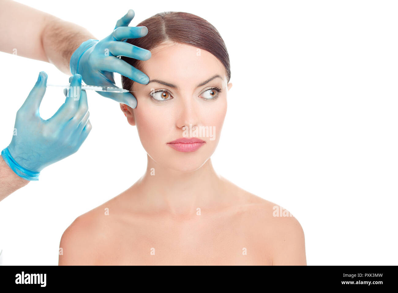 Beautiful female face close-up ready for anti aging serum shot in in face - Stock Image