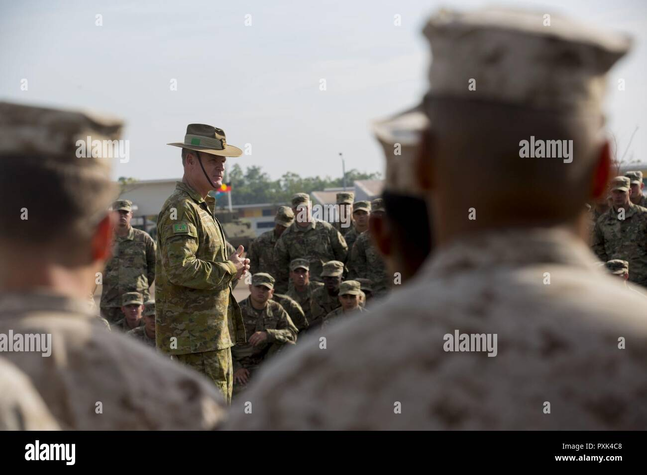 AUSTRALIAN ARMY BASE ROBORTSON BARRACKS, Darwin – Brig. Gen. Ben James, 1st Brigade Commander, Australian Defence Force, speaks to the service members who participated in Exercise Southern Jackaroo 2017 during a closing ceremony, June 1, 2017. Southern Jackaroo 2017 was a multi-lateral combined arms training activity between the U.S. Marines, Australian Army, U.S. Army and Japan Ground Self-Defense Force that allowed participants to train and share military tactics. Stock Photo