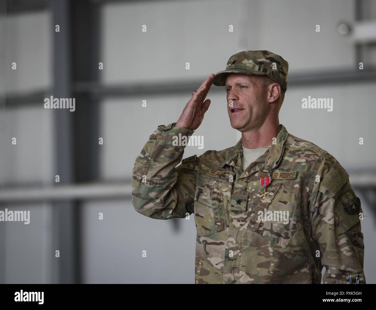 Brig. Gen. Jim Sears renders his final salute as the 455th Air Expeditionary Wing commander during a change of command ceremony at Bagram Airfield, Afghanistan, June 3, 2017. Sears commanded the 455th AEW for the last 12 months. During his time at Bagram, Sears' leadership enabled 15,800 combat sorties, accumulating to 102,877 combat hours, which resulted in more than 1,369 kinetic strike and 2,836 enemies killed in action. Stock Photo