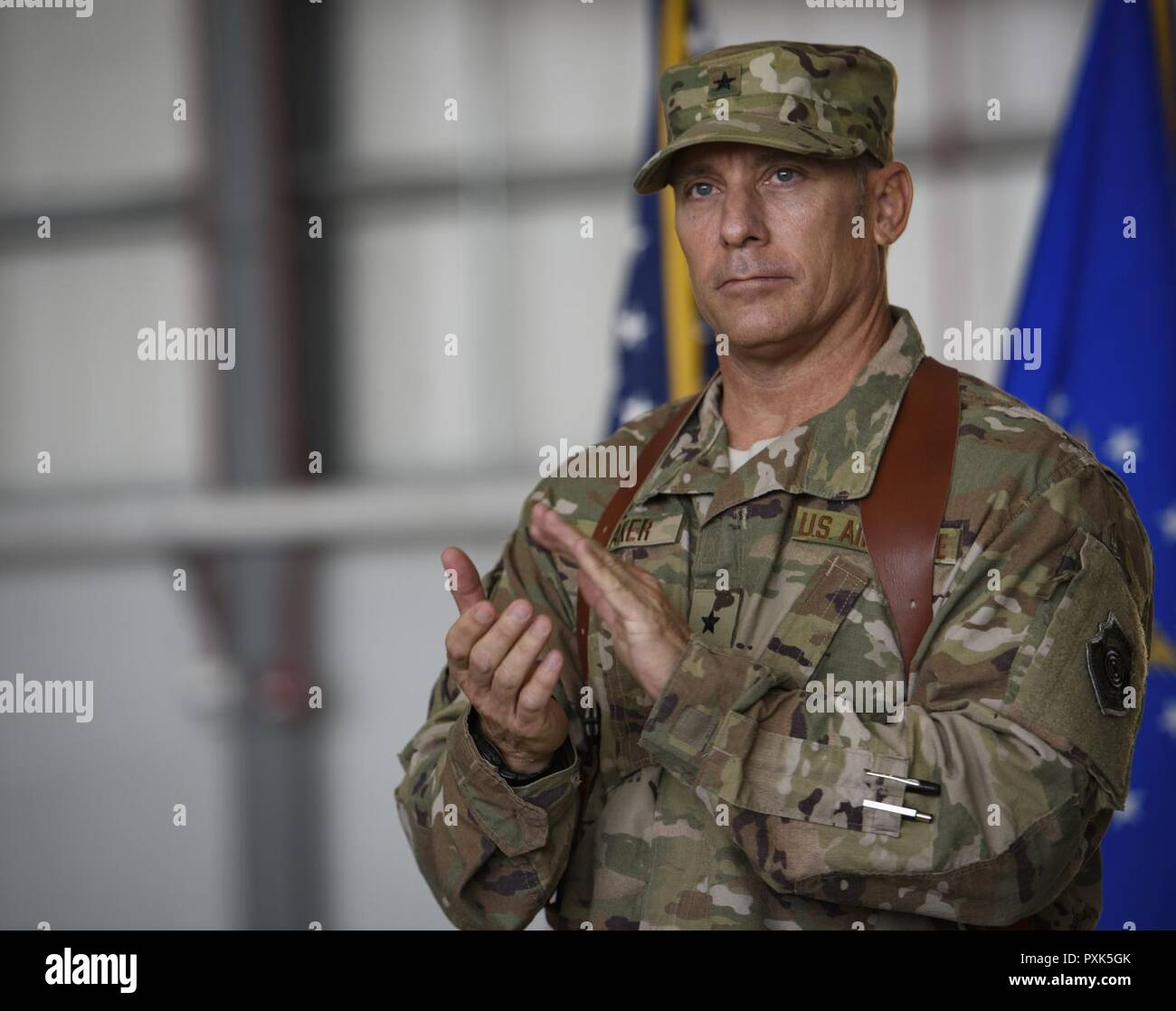 Brig. Gen. Craig Baker, the 455th Air Expeditionary Wing commander, gives a round of applause during a change of command ceremony at Bagram Airfield, Afghanistan, June 3, 2017. As the commander of the 455th AEW, Baker will lead the premier counterterrorism air mission in Afghanistan. The wing's operations enable the NATO Resolute Support mission to successfully train, advise, and assist the military and security forces of Afghanistan, while restricting and deterring the terrorist threat in the region. Stock Photo