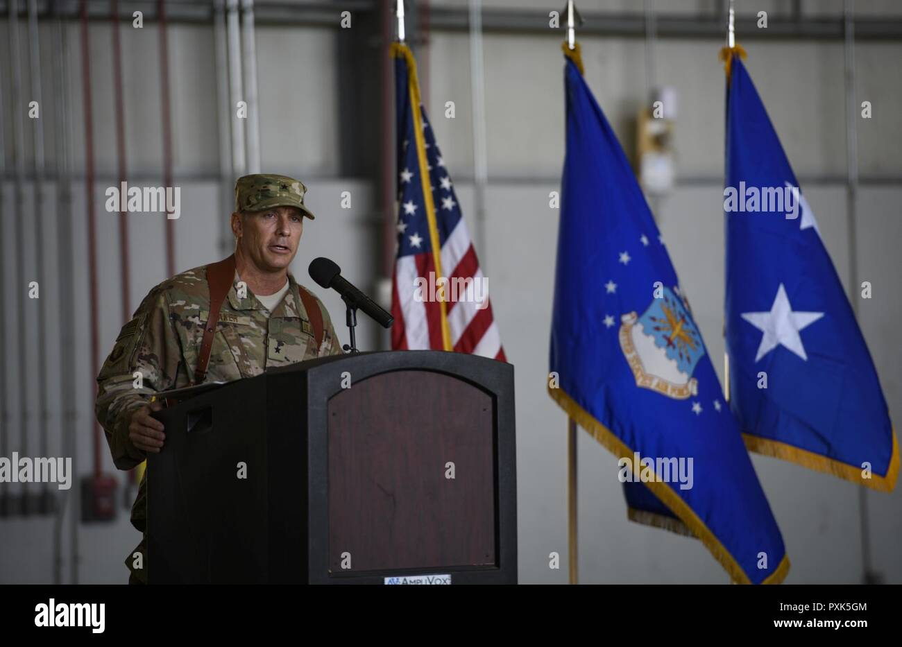 Brig. Gen. Craig Baker, the 455th Air Expeditionary Wing commander, speaks to 455th AEW Airmen and distinguished guests during a change of command ceremony at Bagram Airfield, Afghanistan, June 3, 2017. As the commander of the 455th AEW, Baker will lead the premier counterterrorism air mission in Afghanistan. The wing's operations enable the NATO Resolute Support mission to successfully train, advise, and assist the military and security forces of Afghanistan, while restricting and deterring the terrorist threat in the region. Stock Photo