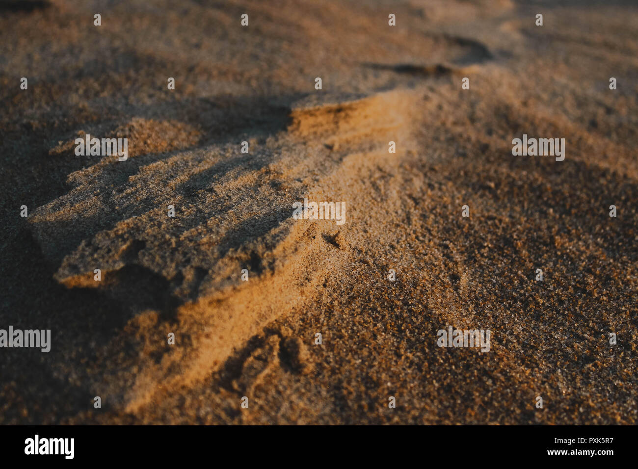 Just sand perfectly piled to look like mountains. - Stock Image