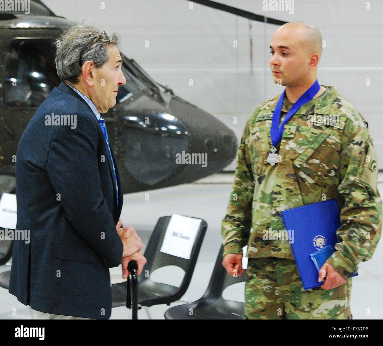 Richard Rosenthal Speaks With Chief Warrant Officer 2 Ronald Ramirez To Express His Gratitude For His Actions Following Rosenthal S Feb 26 Plane Crash Near Gabreski Airport New York Air National Guard Maj
