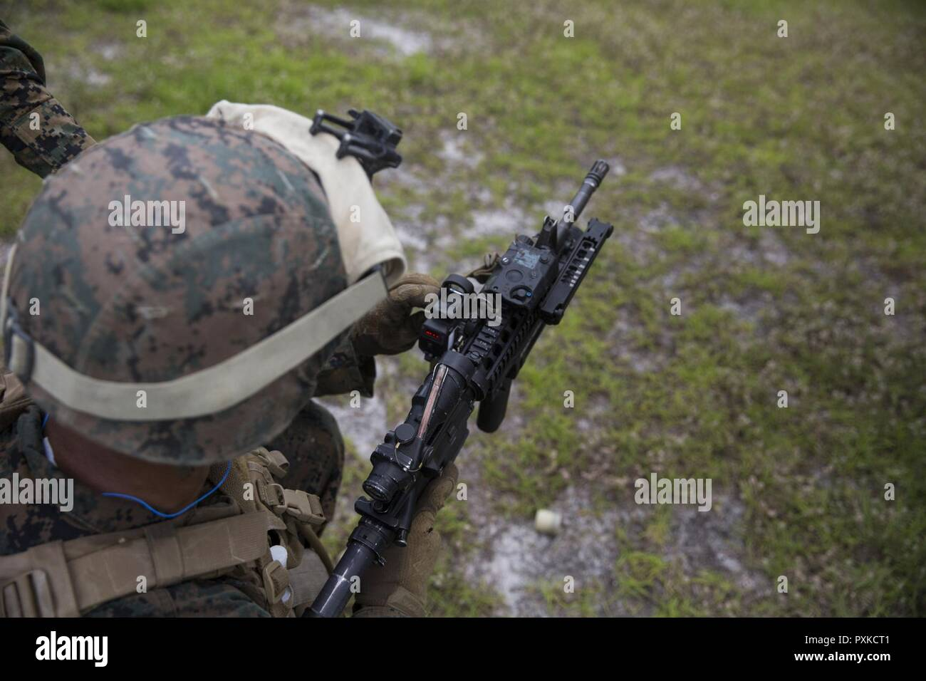 A Marine Calibrates The Sight On M320 Grenade Launcher Module Mounted An M4 Rifle At Camp