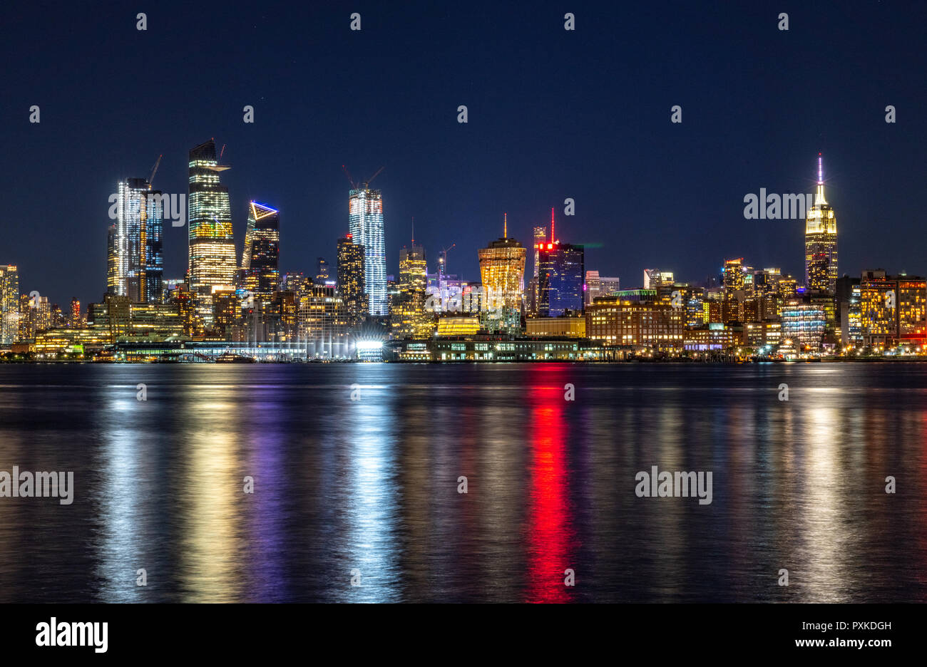 New York, USA, 21 October 2018.  The lights of Manhattan's skyline are reflected on the Hudson river in this photo taken at night from New Jersey. Pho Stock Photo
