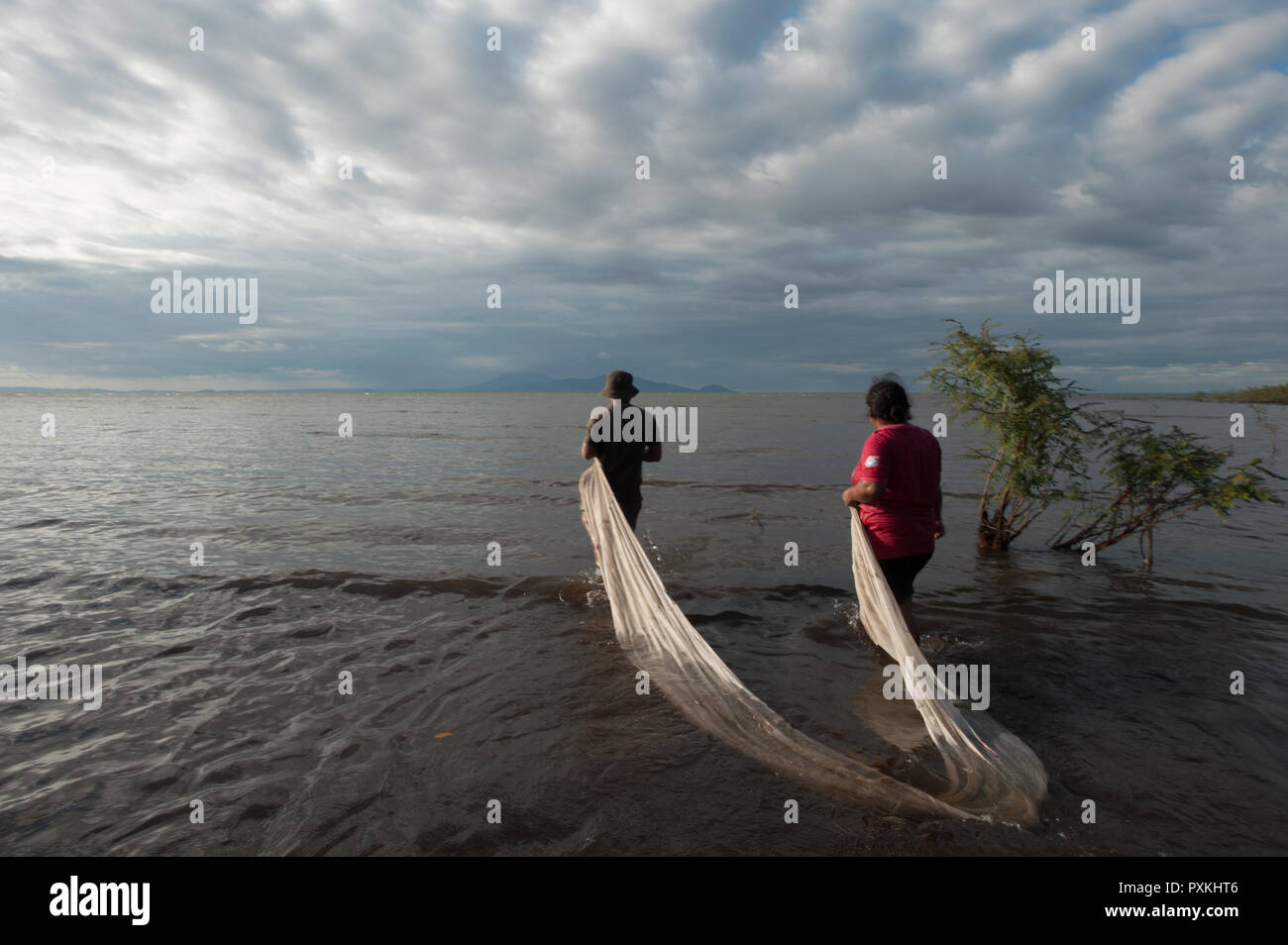 Nearby Moyogalpa practicing an original method of fishing, in two transport network in an area where there is fish, two more people will come running  Stock Photo