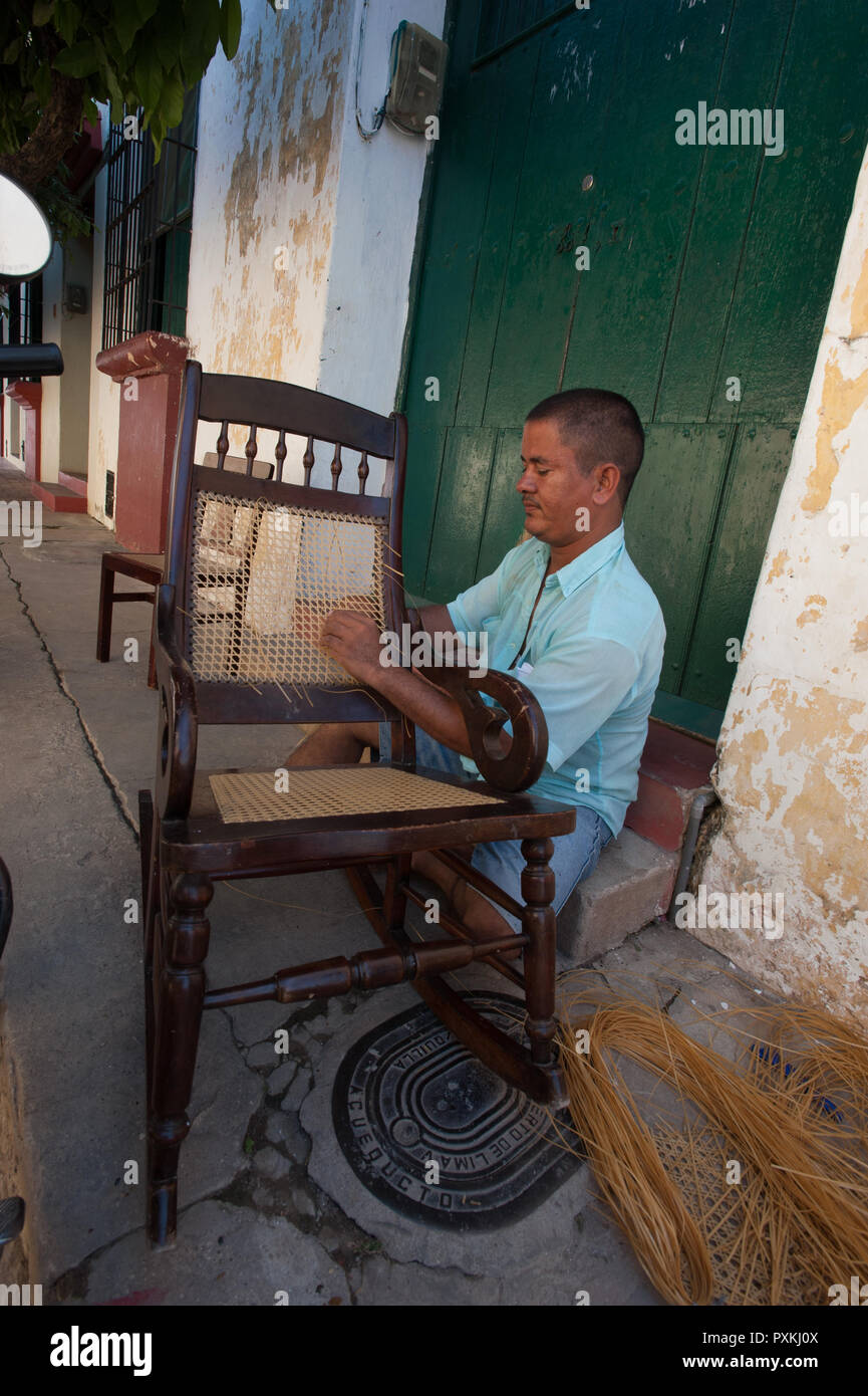 The rocking chair Momposina is a local tradition that is exported all over the world. In every house there is at least one Mompox.Finishing work, on t - Stock Image