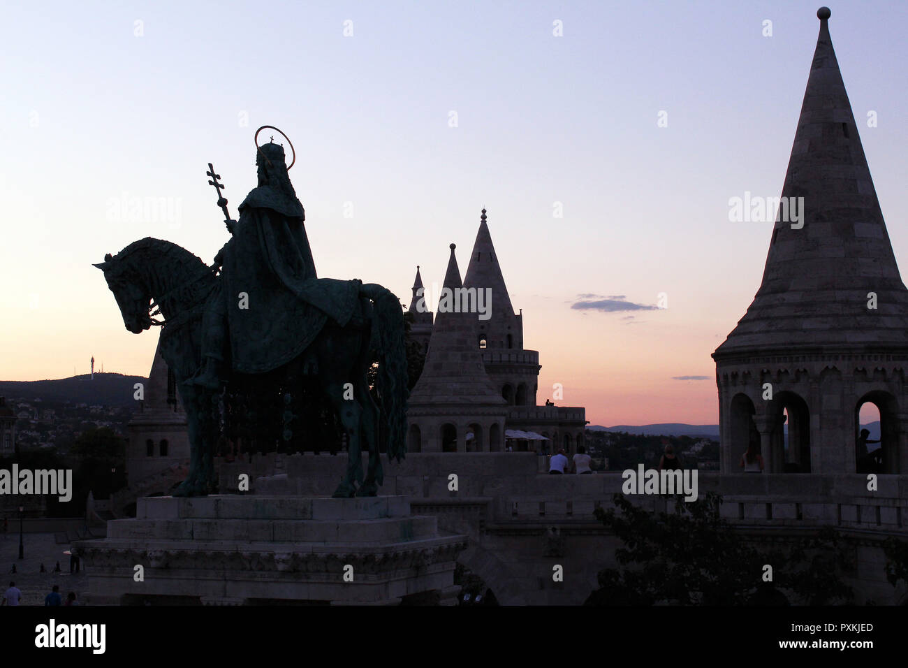 Silhouette of statue of Saint Stephen riding a horse in the sunset Stock Photo