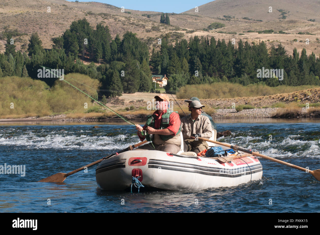 Trout fishing using a fly bait is hand made as one of the trends of the Patagonian region of lakes Stock Photo