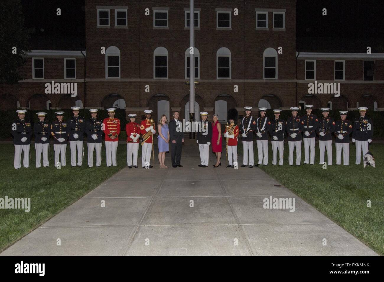 Secretary of the Navy the Honorable Sean J. Stackley, center left, and the Commandant of the Marine Corps Gen. Robert B. Neller, center right, pose for a photo with U.S. Marines from Marine Barracks Washington following an evening parade at Marine Barracks Washington, Washington, D.C., June 9, 2017. Evening parades are held as a means of honoring senior officials, distinguished citizens and supporters of the Marine Corps. Stock Photo
