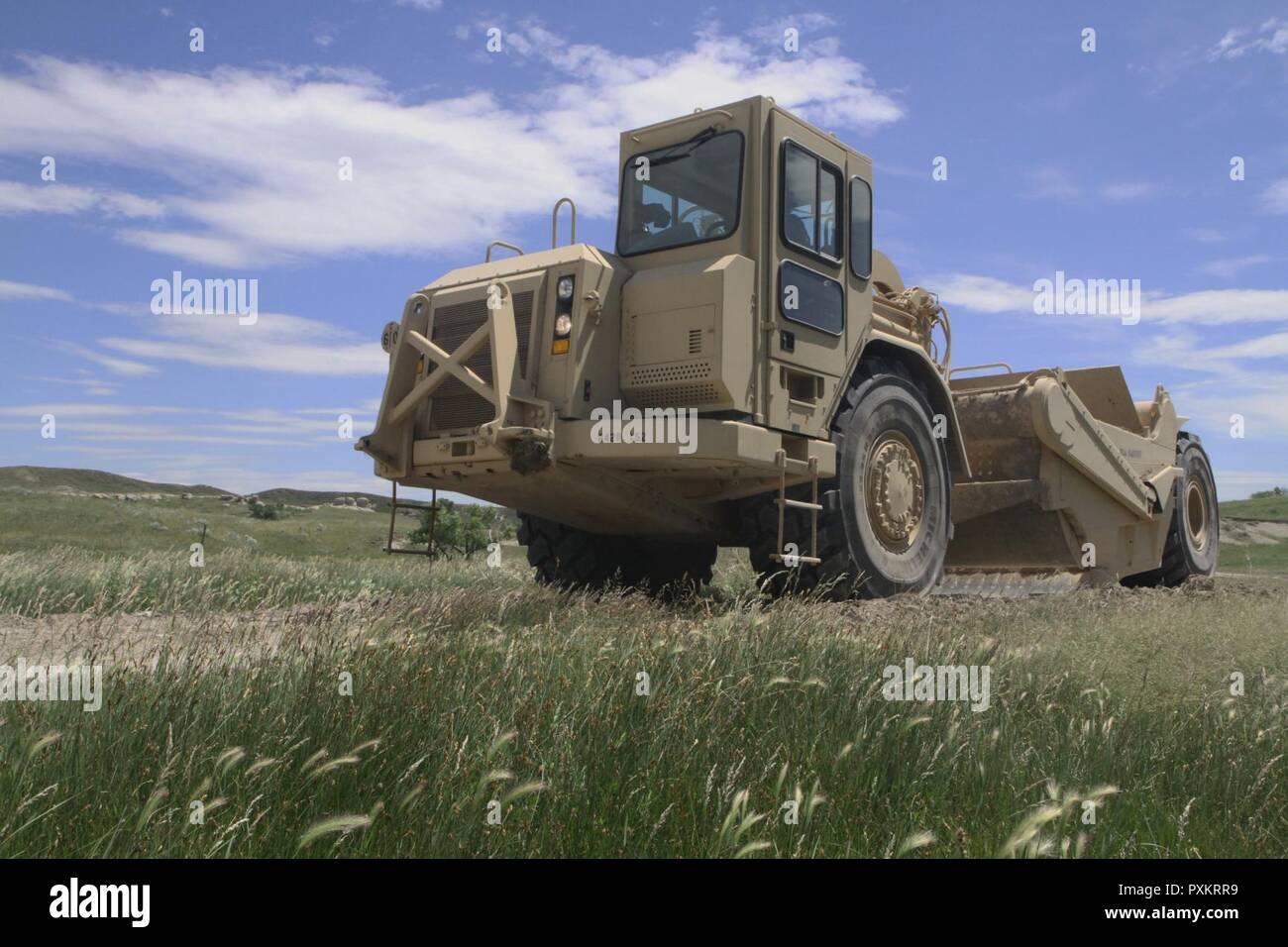 A scraper operator with the South Dakota Army National