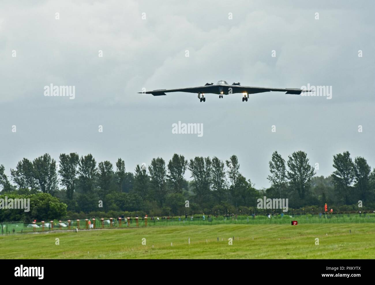 A B-2 Spirit deployed from Whiteman Air Force Base, Mo., approaches the runway at RAF Fairford, U.K., June 9, 2017. The B-2 routinely conducts bomber assurance and deterrence missions providing a flexible and vigilant long-range global strike capability, and is just one demonstration of the U.S. commitment to supporting global security. Stock Photo