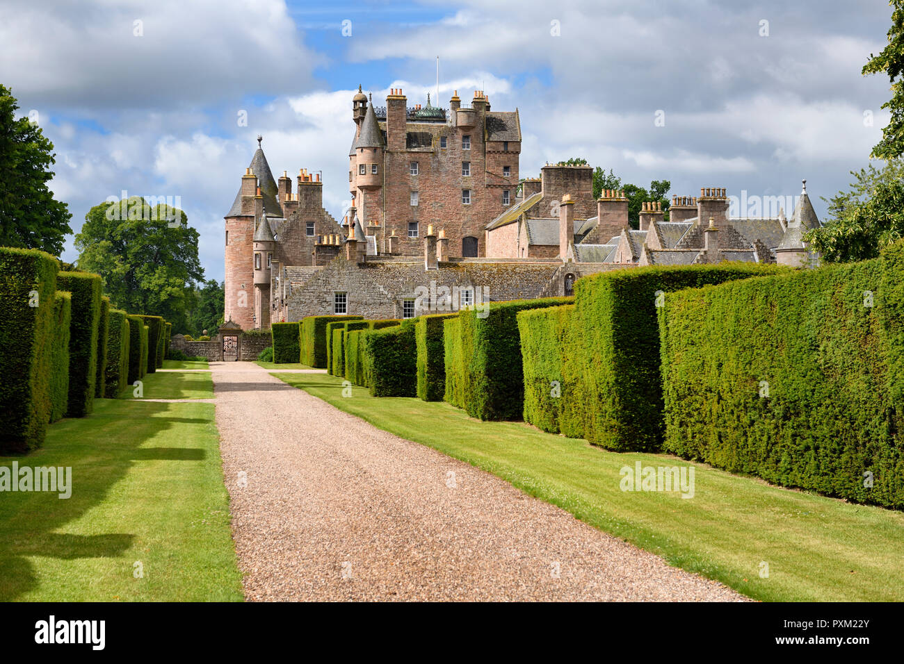 Red stone path with yew hedges in east Italian Garden of Glamis Castle home of Earl and Countess of Strathmore and Kinghorne Scotland UK - Stock Image
