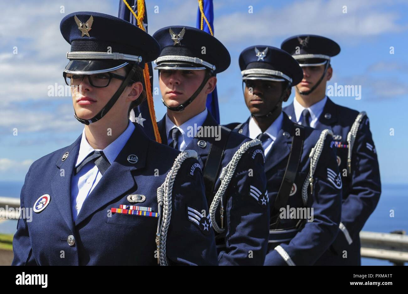 Joint Base Pearl Harbor-Hickam Honor Guard prepares to post the colors during the Detachment 3 Change of Command Ceremony, Kaena Point, Hawaii, June 9, 2017.  Detachment 3 is a component of the 21st Space Operations Squadron, 50th Network Operations Group, 50th Space Wing, and is located on the western tip of Oahu.  It is the oldest and one of seven worldwide remote tracking stations in the Air Force Satellite Control Network. - Stock Image