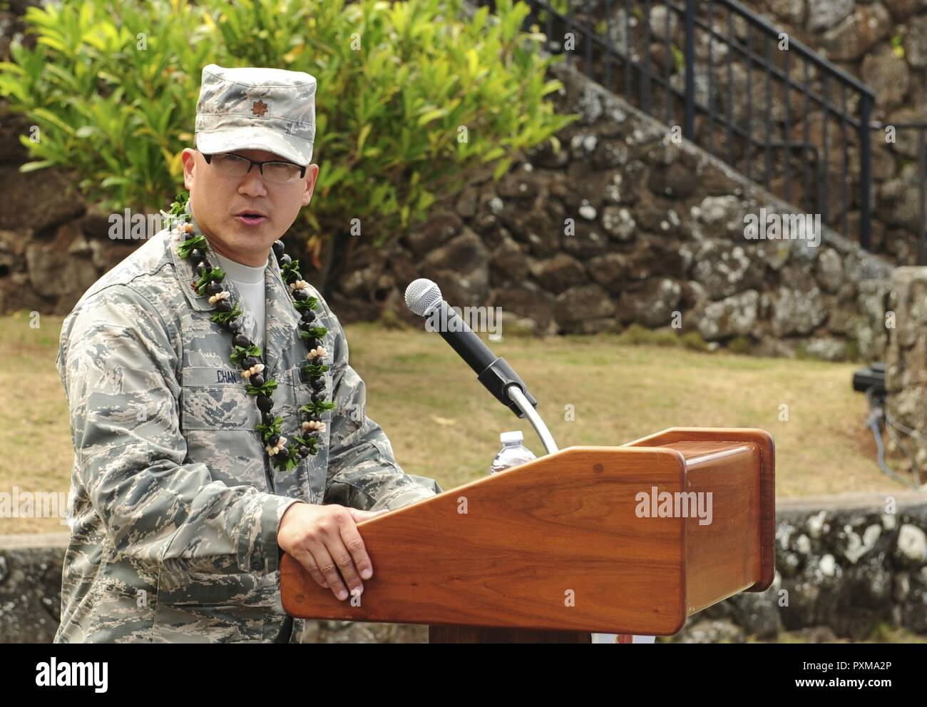 Maj. Edmond Chan, Detachment 3 commander, speaks to his unit during the Detachment 3 Change of Command Ceremony, Kaena Point, Hawaii, June 9, 2017.  Detachment 3 is a component of the 21st Space Operations Squadron, 50th Network Operations Group, 50th Space Wing, and is located on the western tip of Oahu.  It is the oldest and one of seven worldwide remote tracking stations in the Air Force Satellite Control Network. - Stock Image
