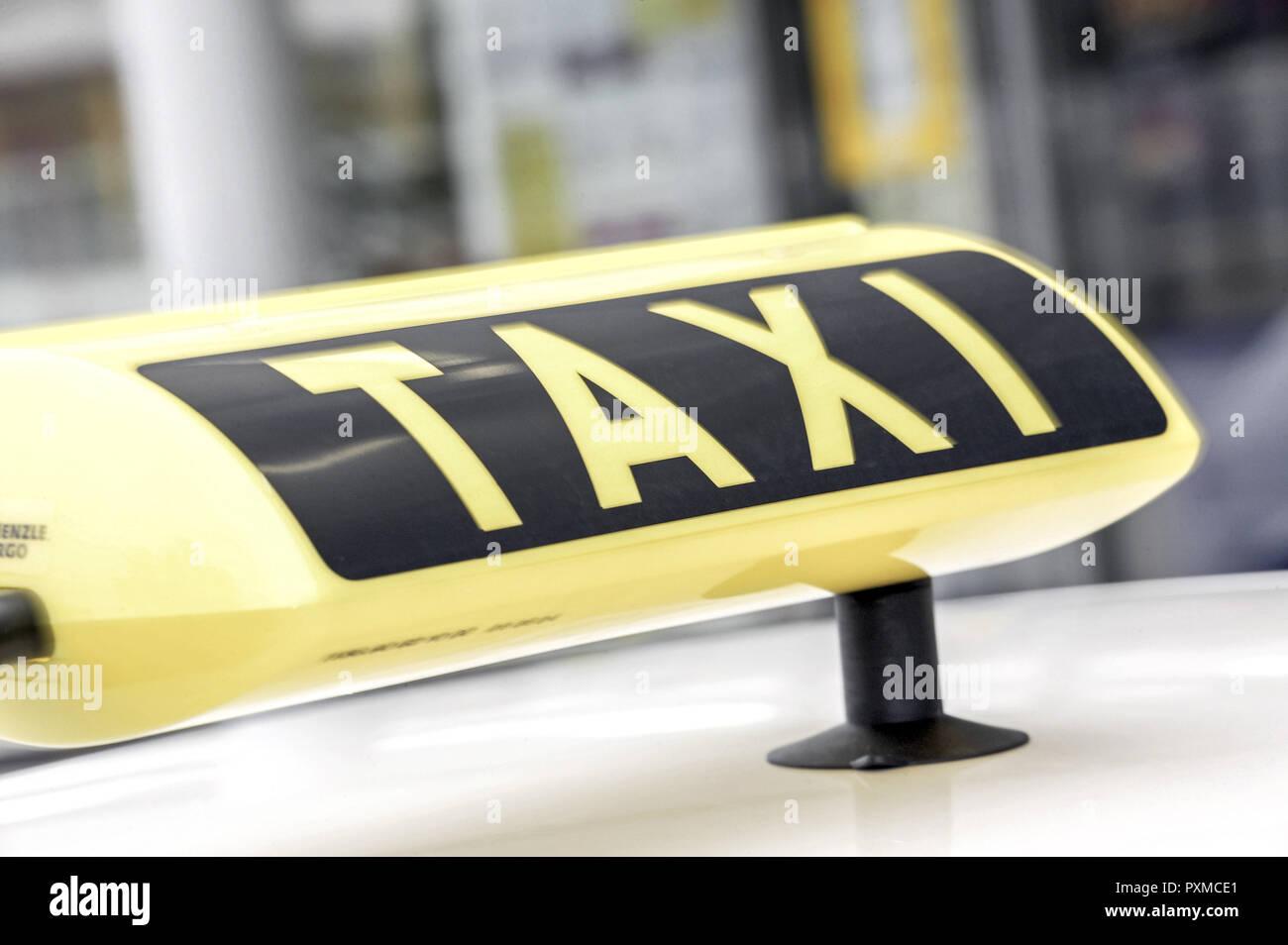 Taxi Detail Auto Close-up Deutschland Europa Nahaufnahme Personentransport Querformat Schild Strassenverkehr Transport Verkehr Symbol - Stock Image