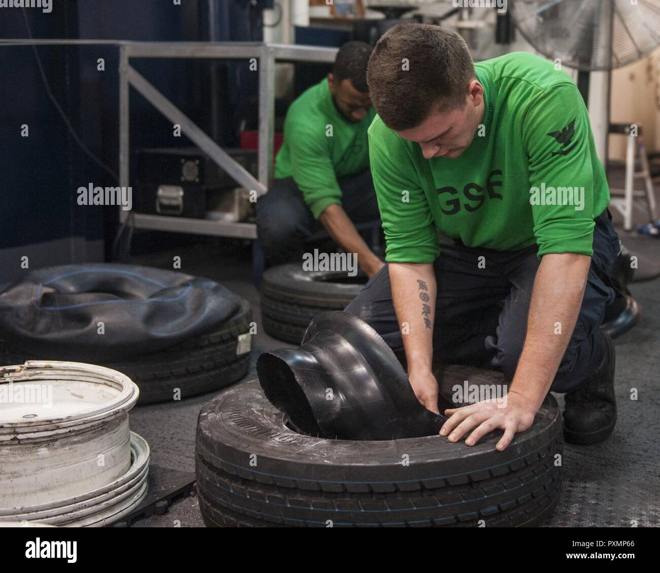 MEDITERRANEAN SEA (June 18, 2017) Aviation Support Equipment Technician 3rd Class Trent Davis powders tires and inner tubes in the IM-4 shop aboard the aircraft carrier USS George H.W. Bush (CVN 77) (GHWB). GHWB, part of the George H.W. Bush Carrier Strike Group (GHWBCSG), is conducting naval operations in the U.S. 6th Fleet area of operations in support of U.S. national security interests in Europe and Africa. Stock Photo