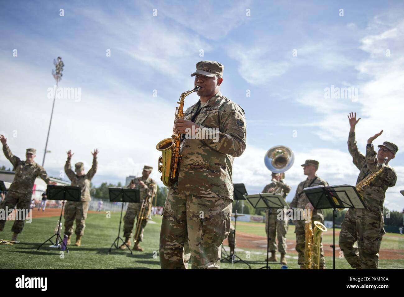 U.S. Army Alaska's 9th Army Band serenades Anchorage area baseball fans at Mulcahy Stadium in Anchorage, Alaska, June 16, 2017. The Anchorage Bucs faced off against the Peninsula Oilers for a doubleheader as part of a military appreciation event. - Stock Image