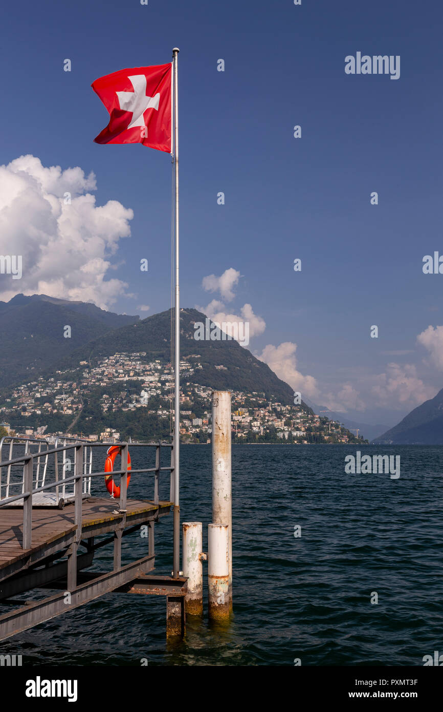 Swiss flag at Lugano on Lake Lugano, Switzerland Stock Photo